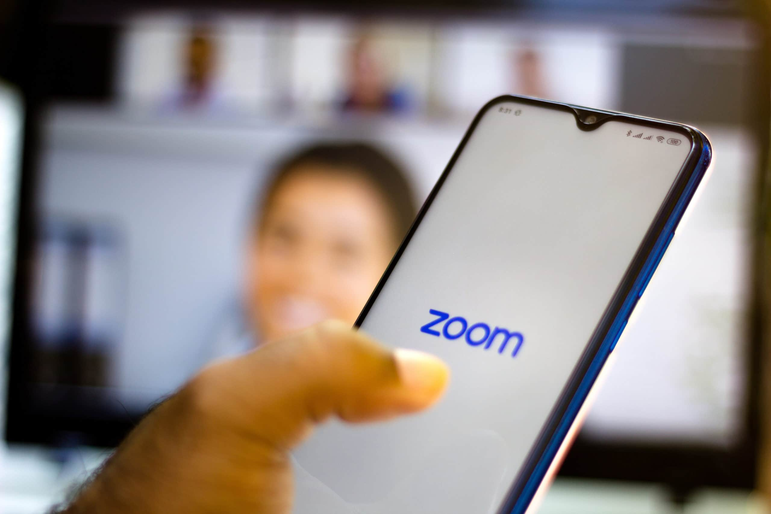In this photo illustration a Zoom Video Communications logo
