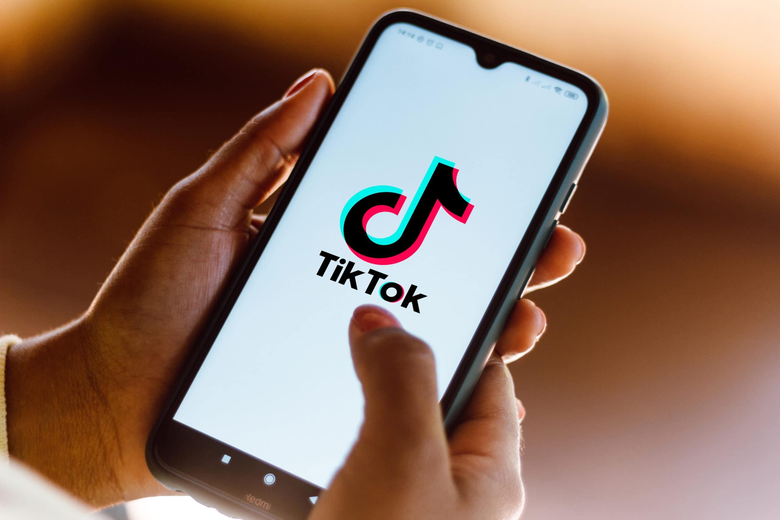 In this photo illustration the TikTok logo seen displayed on