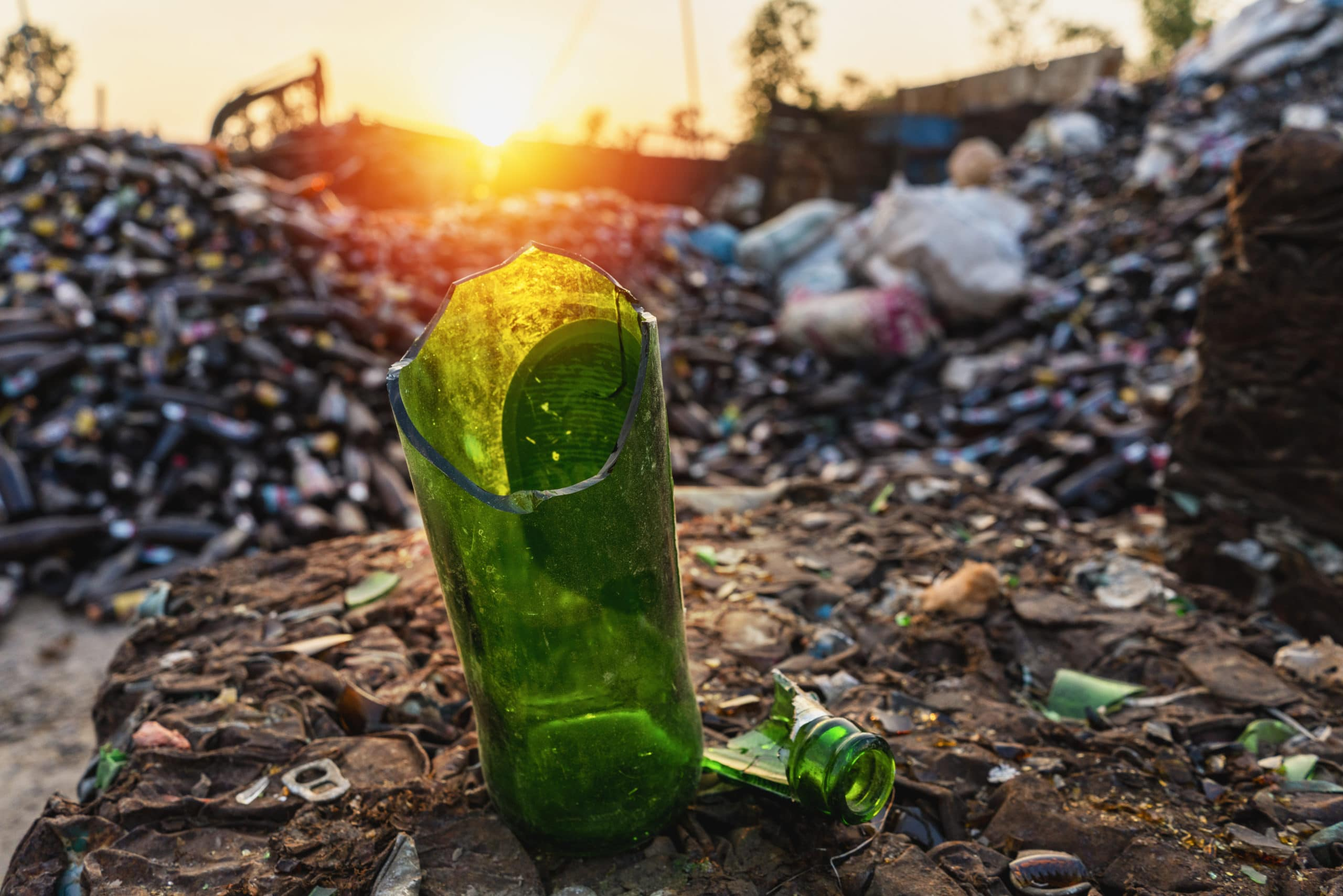 recyclable waste,broken bottles, many broken glass bottles from waste separation factories for recycling.