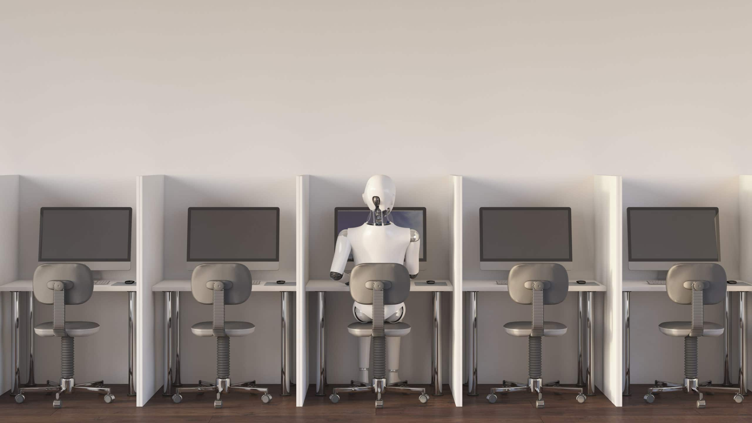 Robot sitting in office, working alone