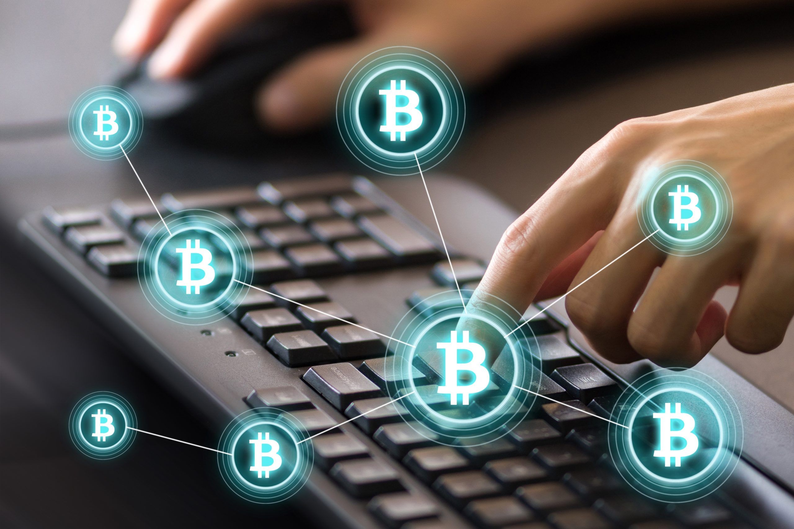 Digital Composite Image Of Cropped Hands Using Computer Keyboard By Bitcoin Icons