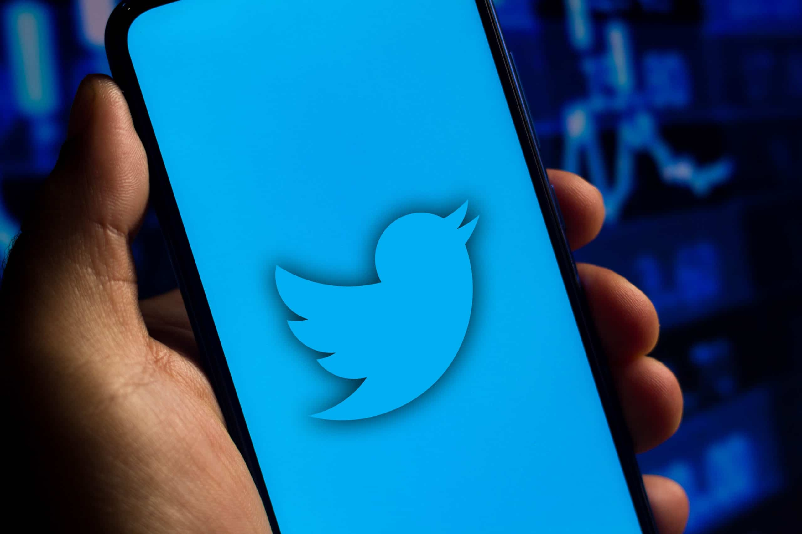 In this photo illustration the Twitter logo seen displayed