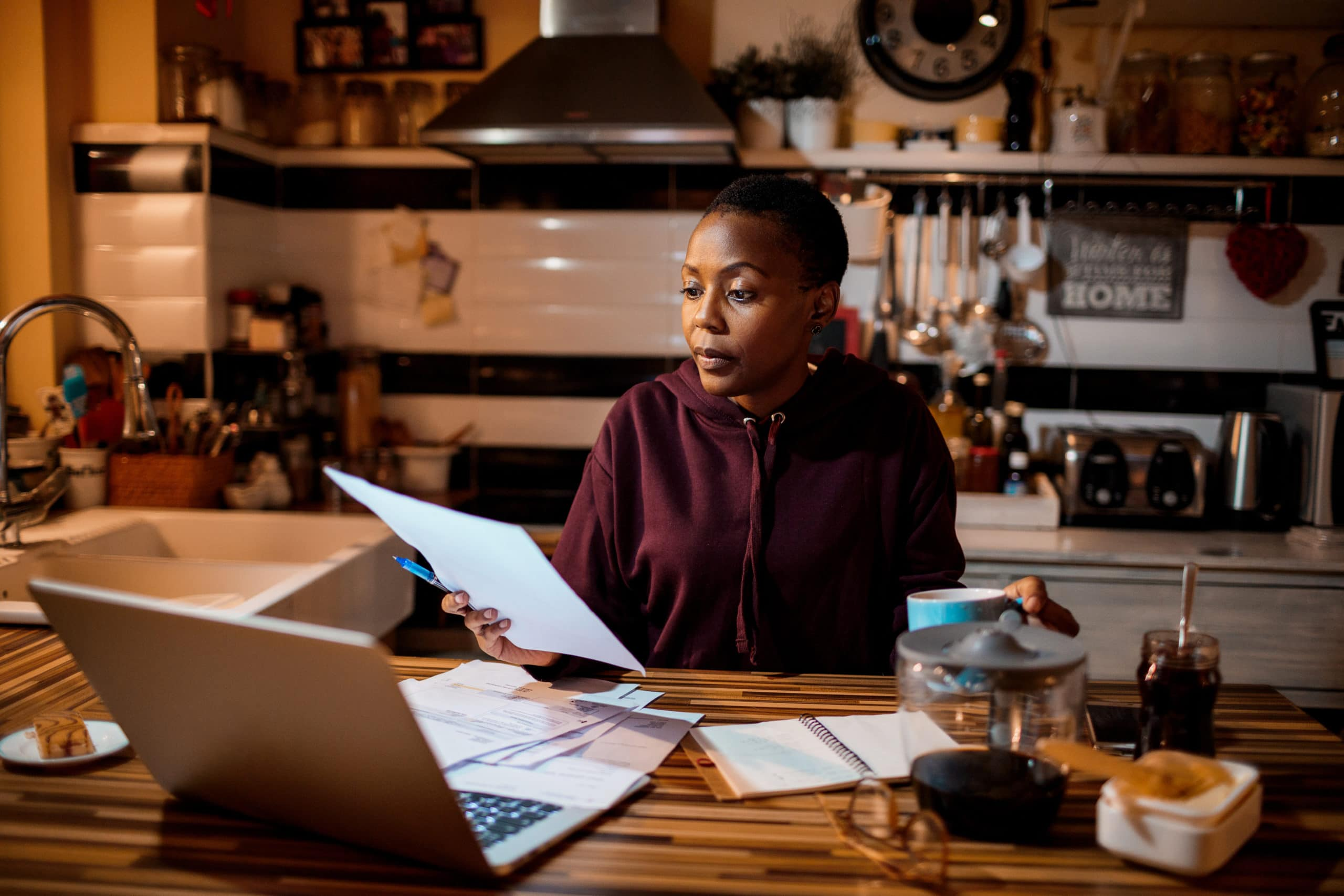 Young woman doing home finances in the evening