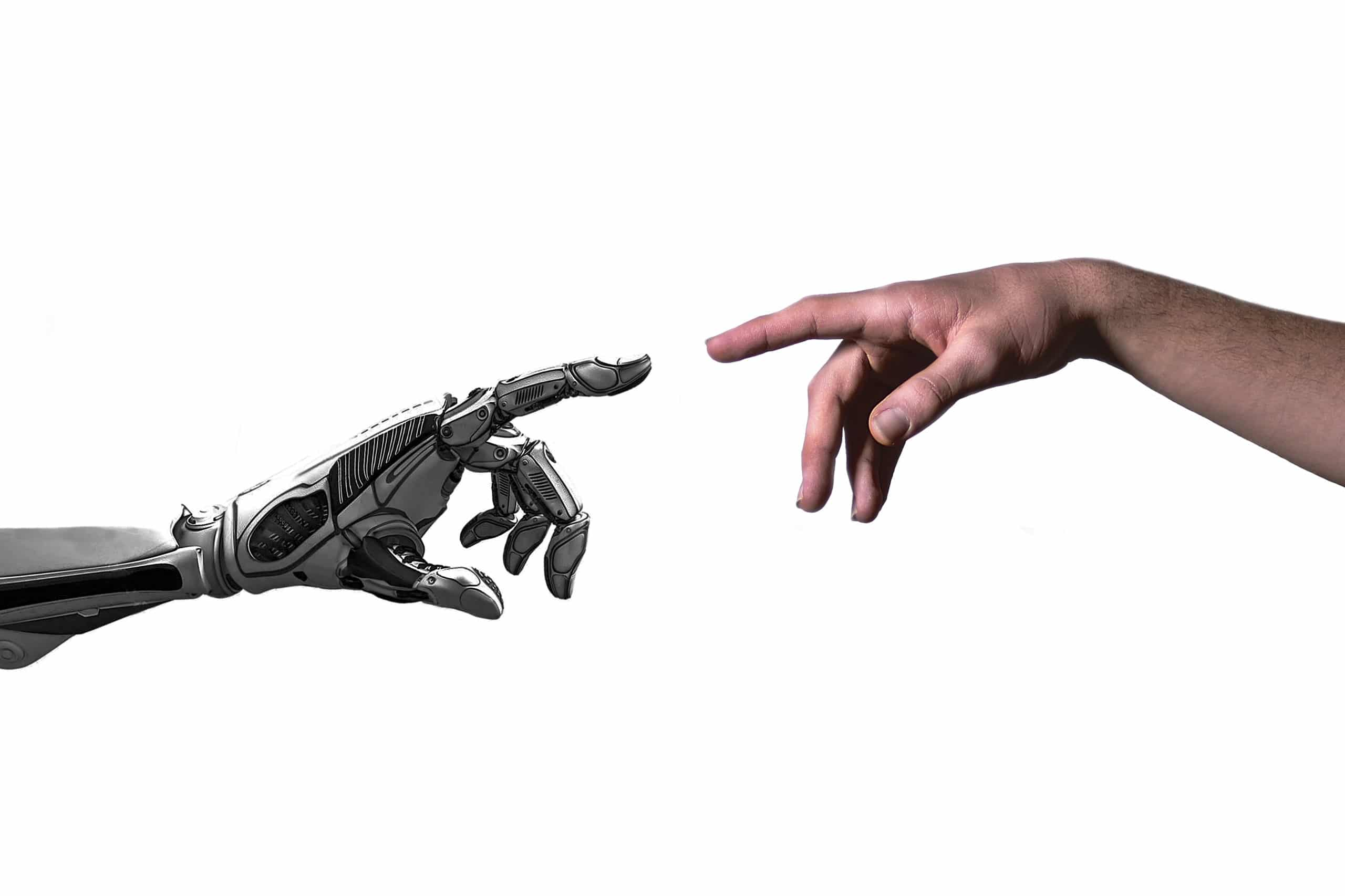 Cropped Hand Touching Robot Against White Background